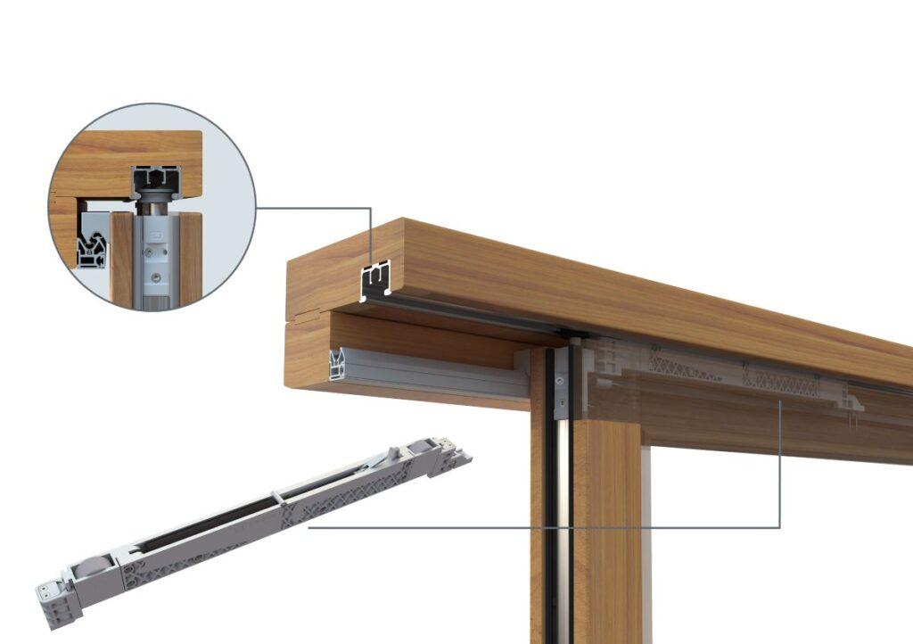 Mechanizm SOFT CLOSE w drewniano-aluminiowych drzwiach podnoszono-przesuwnych.